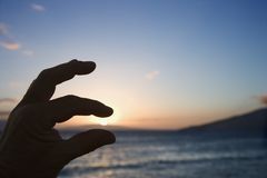 Hand with sunset. Royalty Free Stock Image
