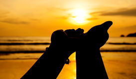 Hand with sunset Royalty Free Stock Photography