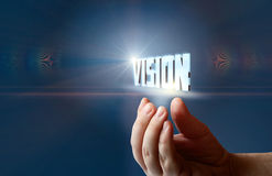 Hand supports the word vision . Stock Photography