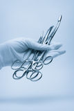 Hand of surgeon Stock Photos