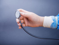 Hand  surgery glove and stethoscope. Hand surgery glove and stethoscope Stock Photo
