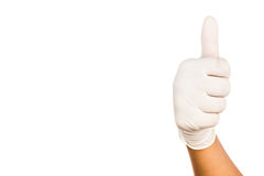 Hand in surgical latex glove gesture Thumbs up good Stock Image