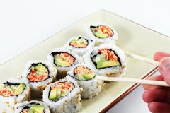 Hand and Sushi Royalty Free Stock Images