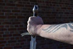 hand svärd Arkivfoto