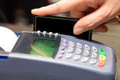 Hand Swiping Blank Credit Card Stock Image