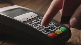 Hand swiping credit card on POS terminal stock footage