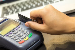 Hand Swiping Credit Card. In Store Royalty Free Stock Image