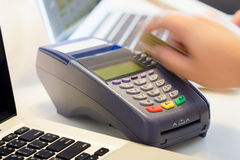 Hand Swiping Credit Card. In Store Royalty Free Stock Photo