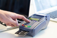 Hand Swiping Credit Card. In Store Royalty Free Stock Images