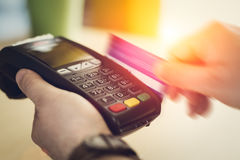 Hand Swiping Credit Card In Store. Closeup picture Royalty Free Stock Images