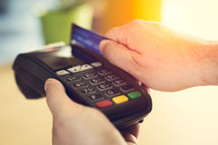 Hand Swiping Credit Card In Store. Closeup picture Stock Photography