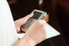 Hand Swiping Debit Card On Pos Terminal Stock Image