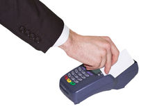 Hand swiping generic credit card on  over counter POS terminal Stock Images