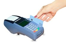 Hand swiping generic credit card on an over. Counter POS terminal over white Stock Photos