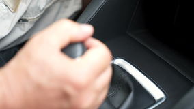 Hand switches the AUTOMATIC TRANSMISSION lever stock footage