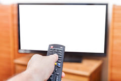 Hand switches TV channels with cut out screen Royalty Free Stock Photography
