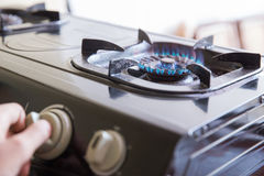 Hand switching a knop on a stove, close up Royalty Free Stock Photo