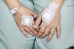 Hand swollen by saline iv. Stock Image