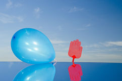 Hand symbol and balloon on mirror Royalty Free Stock Photography