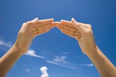 Hand symbolizing house. Photo of hand symbolizing house Royalty Free Stock Images