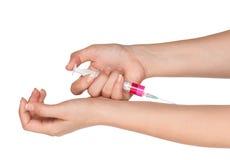 Hand with syringe Stock Photos
