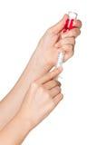 Hand with syringe Stock Photo