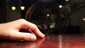 Hand on a table stock footage