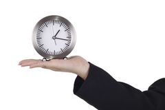 Hand and table clock Stock Photography