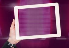 Hand with tablet against dark pink background Royalty Free Stock Photos