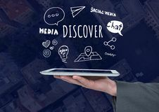 Hand with tablet and Discover text with drawings graphics Royalty Free Stock Photo