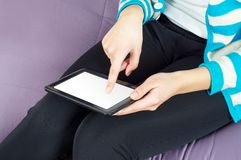 Hand Tablet PC. Young woman using a Tablet PC Stock Photo