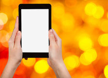 Hand with tablet pc on blurred xmas background Stock Photos