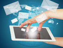 Hand, tablet pc and envelopes Royalty Free Stock Photography