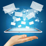 Hand, tablet pc and envelopes Stock Images