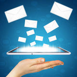 Hand, tablet pc and envelopes Royalty Free Stock Image