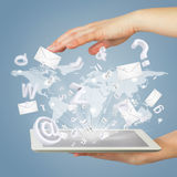 Hand, tablet pc, envelopes and letters Royalty Free Stock Photo