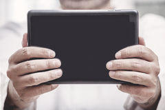 Hand with Tablet PC Royalty Free Stock Photography
