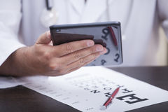 Hand with Tablet PC. Ophthalmologist holds the tablet PC Royalty Free Stock Image