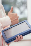 Hand with tablet touch. Male hands holding a tablet touch computer gadget and touches the screen Royalty Free Stock Photos