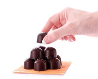 Hand take chocolate isolated Royalty Free Stock Images