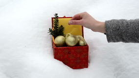Hand take christmas toy retro colorful box winter snow stock video footage