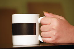 Hand take cup Royalty Free Stock Images