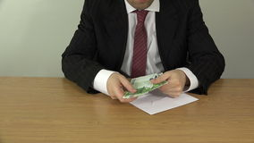 Hand take euro banknote from envelope and put in suit pocket stock footage