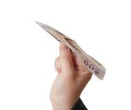 Hand take money plane Stock Image