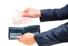 Hand take money in the wallet. On white background stock image