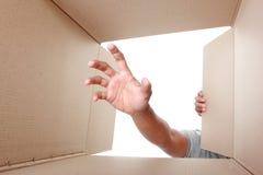 Hand take something inside box Royalty Free Stock Image