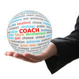 Hand take white ball with red inscription coach Royalty Free Stock Images