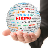 Hand take white ball with red inscription hiring Stock Image