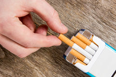 Hand takes a cigarette. Out of pack Royalty Free Stock Photos