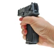 The hand takes a handgun Royalty Free Stock Photography